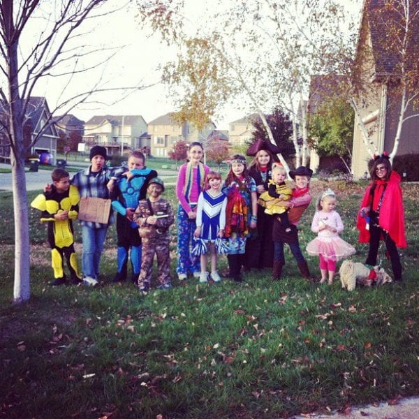 a group of kids dressed up for Halloween in a yard in Kansas