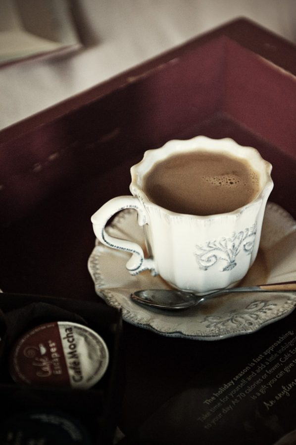 Cup of steaming Cafe Escapes Flavored Coffee