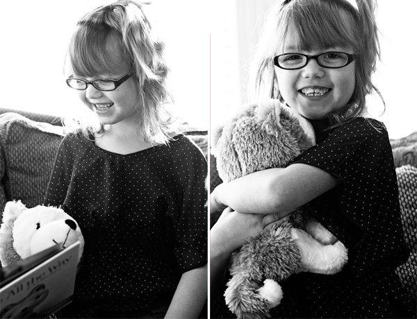 Girl Hugging Jingle the Interactive Story Dog from Hallmark