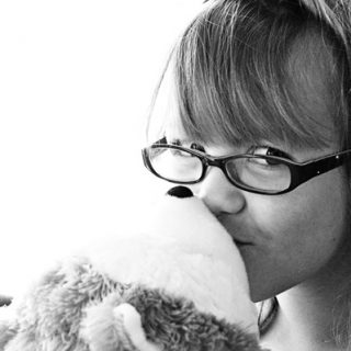 Girl Kissing Hallmark Jingle Stuffed Dog