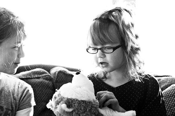 Girl talking to Jingle the Hallmark Interaactive Story Dog