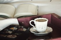 Cafe Escapes Coffee Cup on Bed with Book Relax