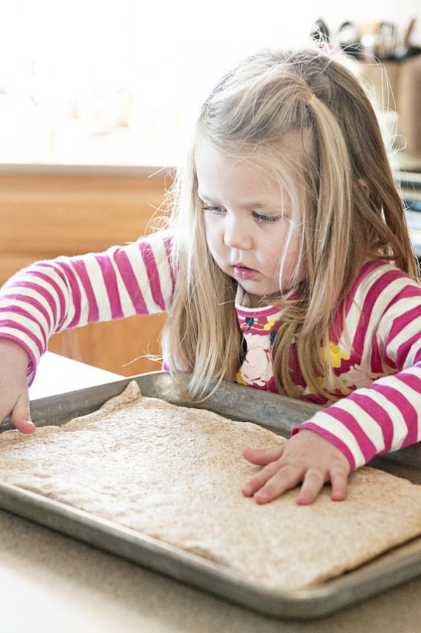 Little Girl Rolling Pizza Dough