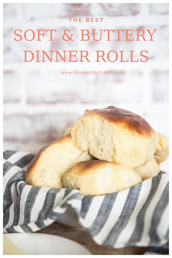 basket of dinner rolls with brick background
