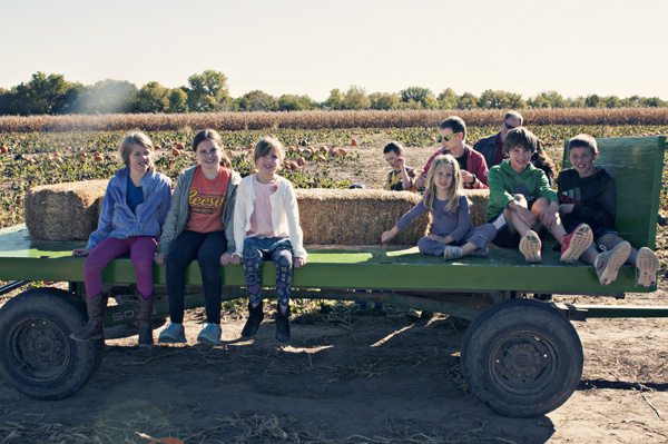Wagon full of Doyle kids at the pumpkin patch