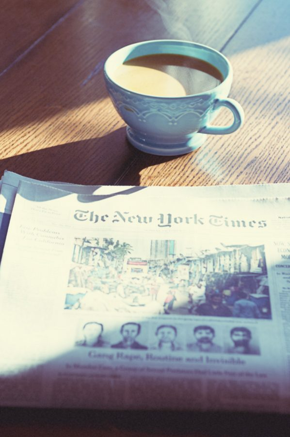 Steaming Coffee and Newspaper on Sunday