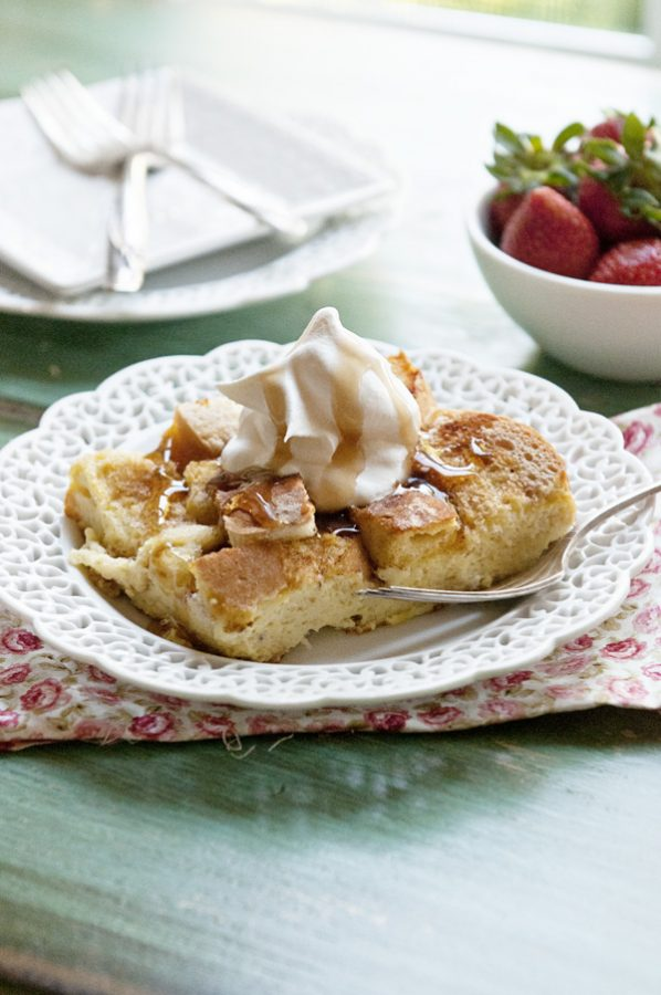 French Toast Casserole on a white plate and green table