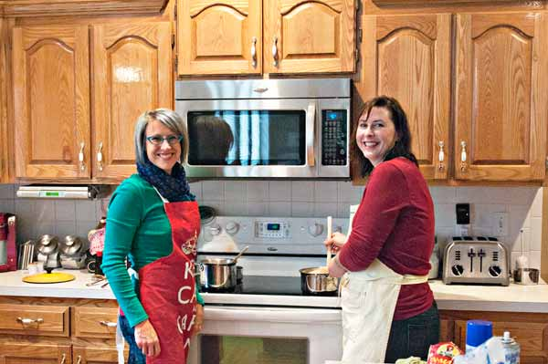 Girls-Cooking-by-Stove-Small