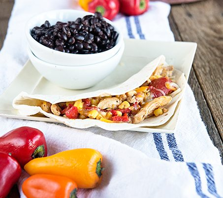Saucy Shredded Chicken Tacos recipe on dineanddish.net