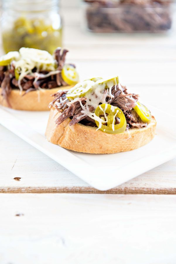 These simple slow cooker roast beef sandwiches will become a favorite to make for your family!