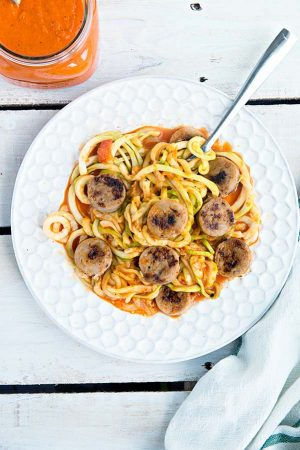 Chicken Sausage with Roasted Red Pepper Sauce Over Zucchini Noodles
