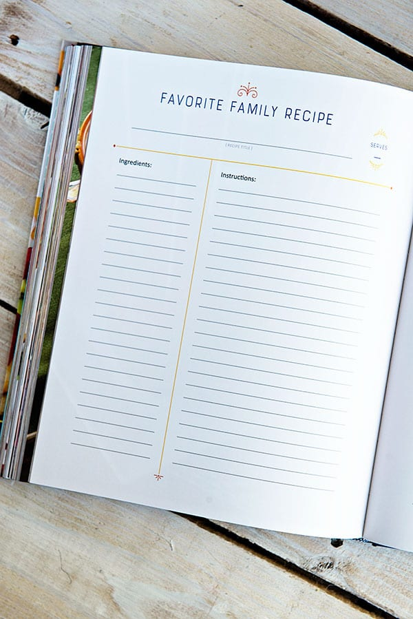 An open cookbook page on a white wooden background