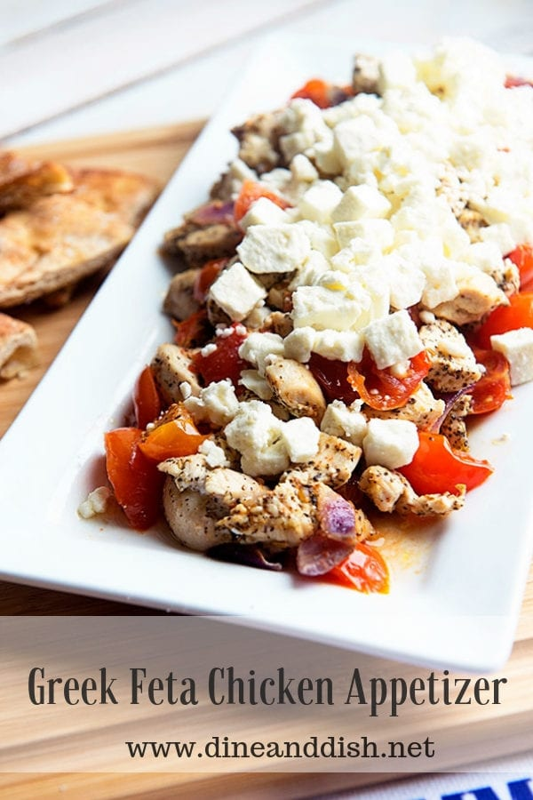 Greek Feta Chicken Appetizer on a white plate with tomatoes and red onions