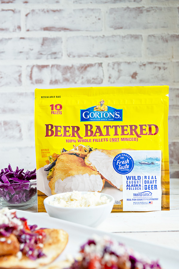 Yellow Bag of Gorton's Beer Battered Fish Fillets in front of a white brick background