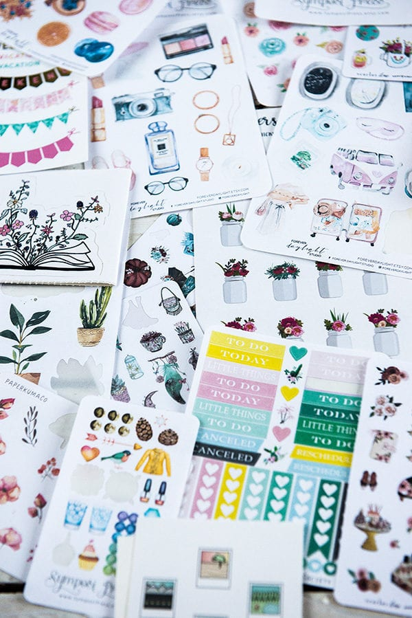 table full of bullet journal stickers