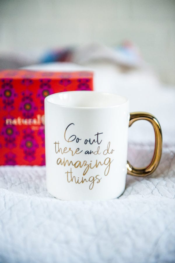 Natural Life Coffee Mug that says Go Out There And Do Amazing Things