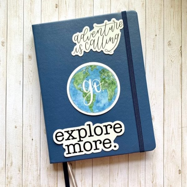 Blue journal with 3 bullet journal quote stickers on the front