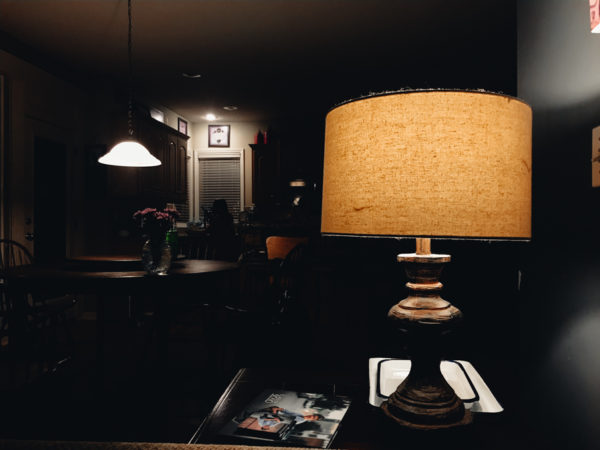 A dusty lamp in a dark room
