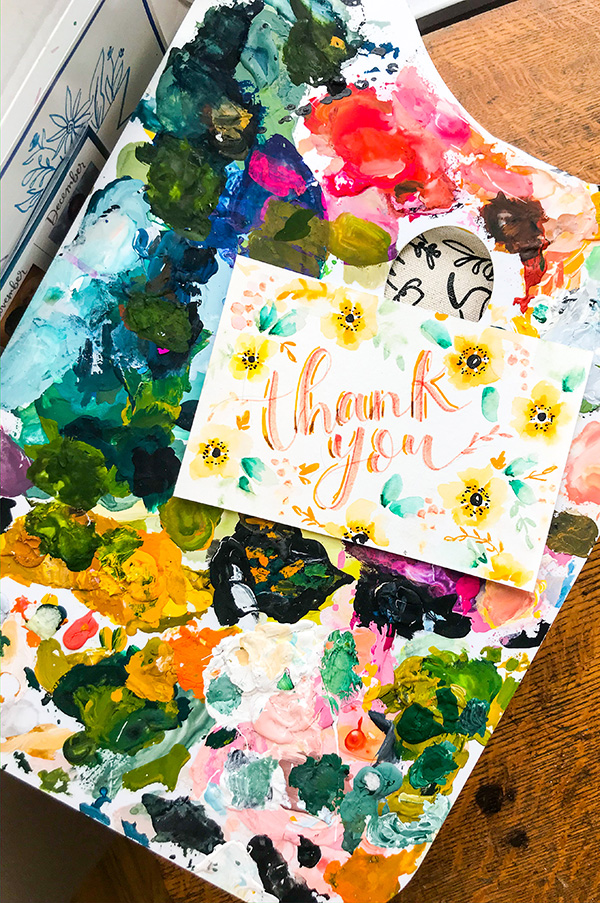 Thank you note on a watercolor paint palate